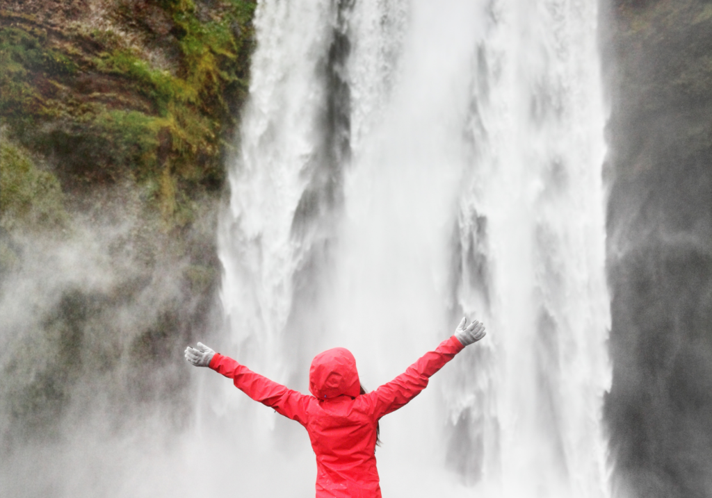 Women in front of waterfall